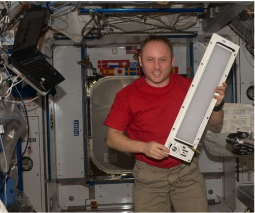 Photo courtesy of NASA Electric light is coming to the astronauts' aid in the form of a programmable LED wavelength system. U.S. Astronaut Mike Fincke holds an early prototype of an LED lighting unit that was installed on the space station during Expedition 18 about six years ago.