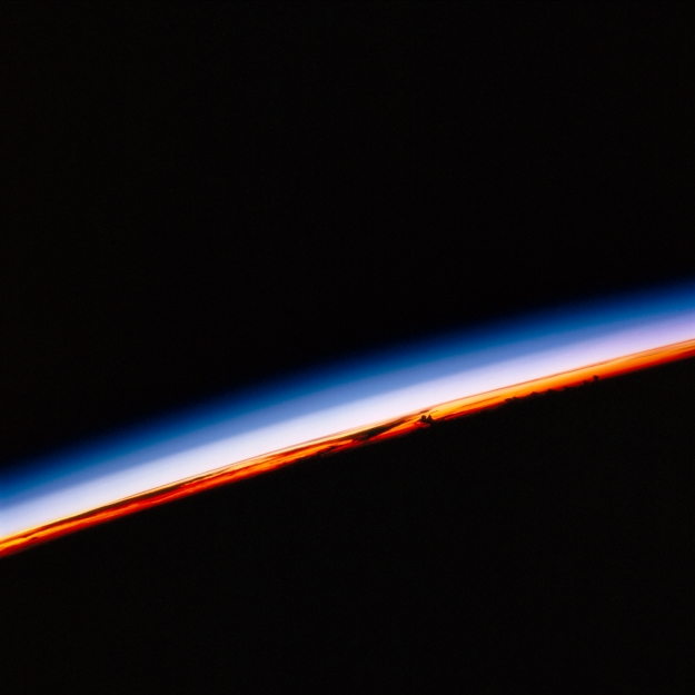 NASA Identifier: iss002-702-085 On Earth, we experience one sunrise and sunset in a 24-hour day. But in a flood of the full spectrum of light, International Space Station crews see about 16 sunrises and sunsets in that same time frame. This sunrise view was taken by the Expedition Two crew in 2010.