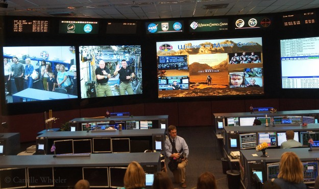 "Tuesday, Sept. 15 was a special day for NASA astronaut Scott Kelly (left in second screen from left), who marked the halfway point of his historic one-year stay on the International Space Station. Adding to the festivities in Johnson Space Center's International Space Station Flight Control Room was the presence (from left, far-left screen) of JSC Director Ellen Ochoa, ""The Martian"" movie actors Sebastian Stan and MacKenzie Davis, and family members on hand to say hello to Kelly and fellow astronaut Kjell Lindgren. Stan and Davis asked the astronauts questions in a live downlink conversation."