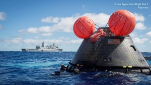 "Image courtesy of NASA's Johnson Space Center NASA engineer Kelly Smith describes the Orion spacecraft, shown here after Exploration Flight Test 1 splashdown, as looking like an ""iron gumdrop."""