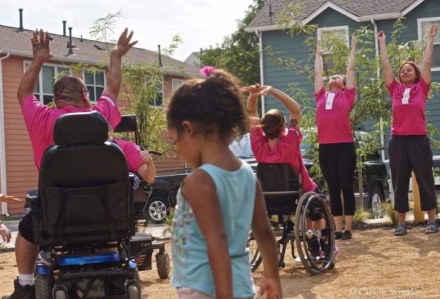 Some children, suddenly inspired and curious, couldn't help but wander into the dance space of Body Shift's Sept. 27 ECHO performance. From back right, counterclockwise, Peggy Lamb and Ashley Card (with arms raised), Tanya Winters, Susie Angel (obscured, in wheelchair), and Juan Muñoz perform.