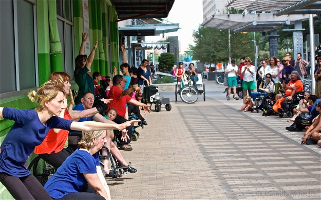 Body Shift creates community in a variety of performance venues, including the streets of downtown Austin, as seen above. This April 2014 performance, called Crippin' the Streets, kept Body Shift dancers and onlookers in close proximity.