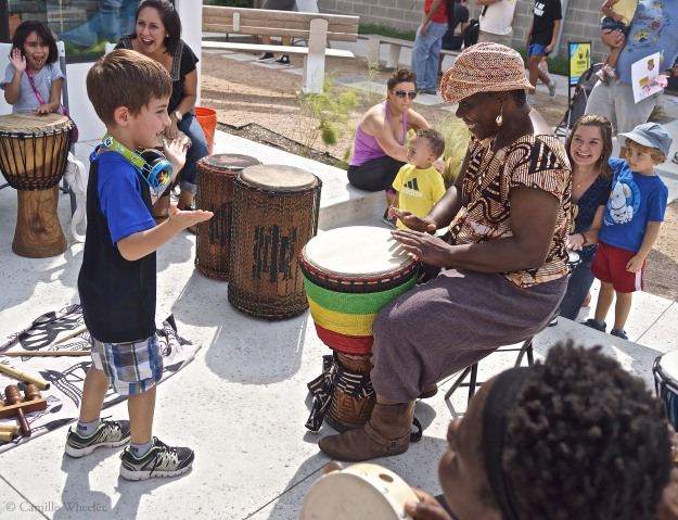 Drum faster! With palms raised, and eyes trained on African drum circle leader Tonya Lyles, 5-year-old Alexander Strong controls the tempo of one particularly upbeat number during the Sept. 27 Community Art Sunday at the Center for Creative Action in East Austin.