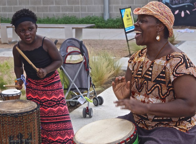 Six-year-old Jeriah Hill plays a bass drum with confidence as she follows the lead of African drum circle leader Tonya Lyles during the Sept. 27 Community Art Center at the Center for Creative Action in East Austin.