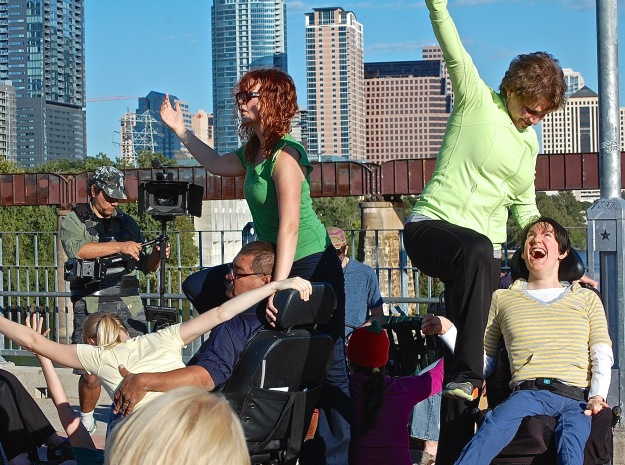 Photo by Carol Moczygemba From left: Silva Laukkanen, Juan Munoz, Melissa Grogan, Shaniqua Ezparza (crouching, orange hat), Elvira Junuzovic, and Marnie Paul create a sculpture during Body Shift's October 2013 Bridging the Gap performance on the Lady Bird Lake pedestrian bridge in Central Austin.