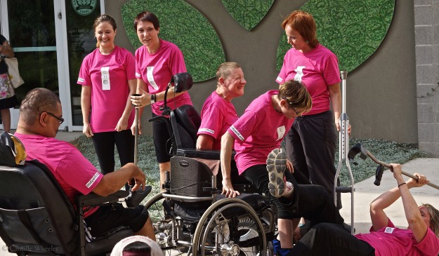 There's great depth to the dance of Body Shift, and there's great fun — an infectious playfulness that inspires confidence. From back left, clockwise, Ashley Card, Silva Laukkanen, Susie Angel, Peggy Lamb (holding crutch), Tanya Winters (sitting in front of Angel on wheelchair), Donna Woods (on ground), and Juan Muñoz celebrate their work in ECHO, a performance piece delivered as part of the Sept. 27 Community Art Sunday at the Center for Creative Action in East Austin.