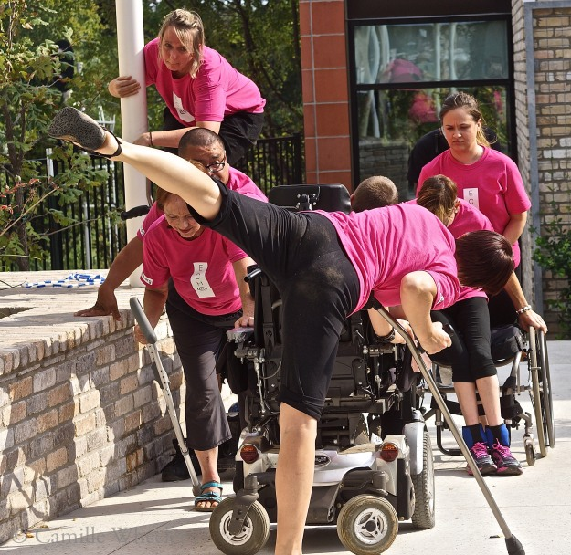 On the move: Choreographer Silva Laukkanen (foreground) and Body Shift dancers Susie Angel (in wheelchair), Peggy Lamb, Juan Munoz, and Donna Woods (at left, front to back), Tanya Winters (head down, beside Angel) and Ashley Card (back right) build a statue during their ECHO performance on Sept. 27, 2015, at the Center for Creative Action in East Austin.