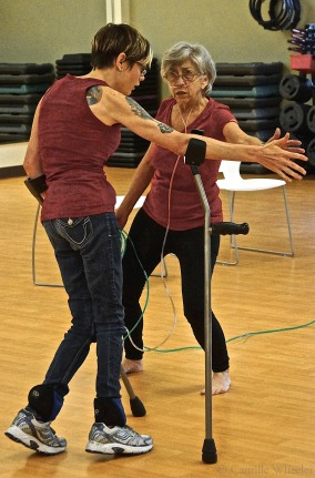 Tanya Winters, left, and Laura Burns incorporated the use of walking sticks, or crutches, and an oxygen tank into their Body Shift Choreography Lab duet on Aug. 22, 2015.