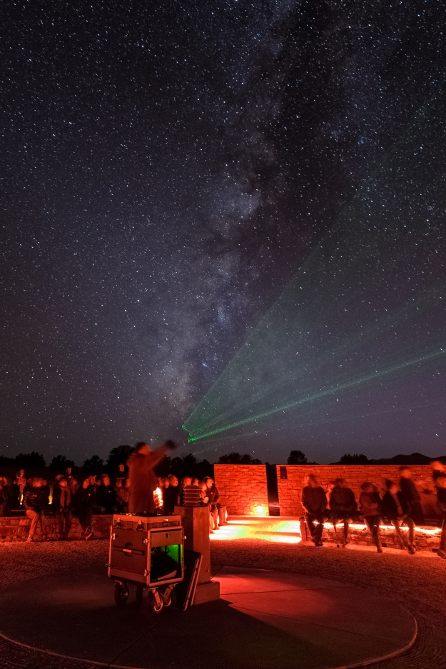 Photo credit: Ethan Tweedie Photography With the Milky Way clearly visible in a dark night sky over McDonald Observatory, a program leader points to constellations from the Frank N. Bash Visitors Center's outdoor amphitheater.