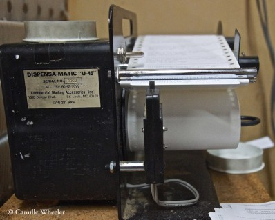 """The Rockdale Reporter is prepared for mailing with the help of this Dispensa-Matic """"U-45"""" labeler."""