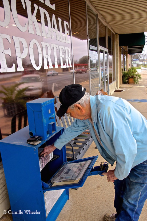 Eugene Lane, an 82-year-old Rockdale resident who has been reading The Rockdale Reporter for 40 years, grabs a newspaper hot off the press.