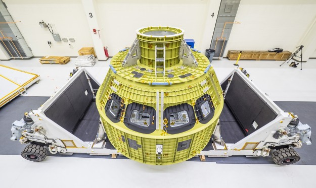 Photo credit: NASA/Radislav Sinyak Orion, NASA's deep-space exploration vehicle, is being prepared at NASA's Kennedy Space Center for a 2018 test flight called Exploration Mission-1. Orion, with no humans aboard, will be thrust into space atop the Space Launch System rocket and then travel roughly 40,000 miles beyond the moon over the course of a three-week mission.